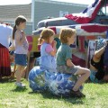 Children sitting on two 16-inch EarthBalls
