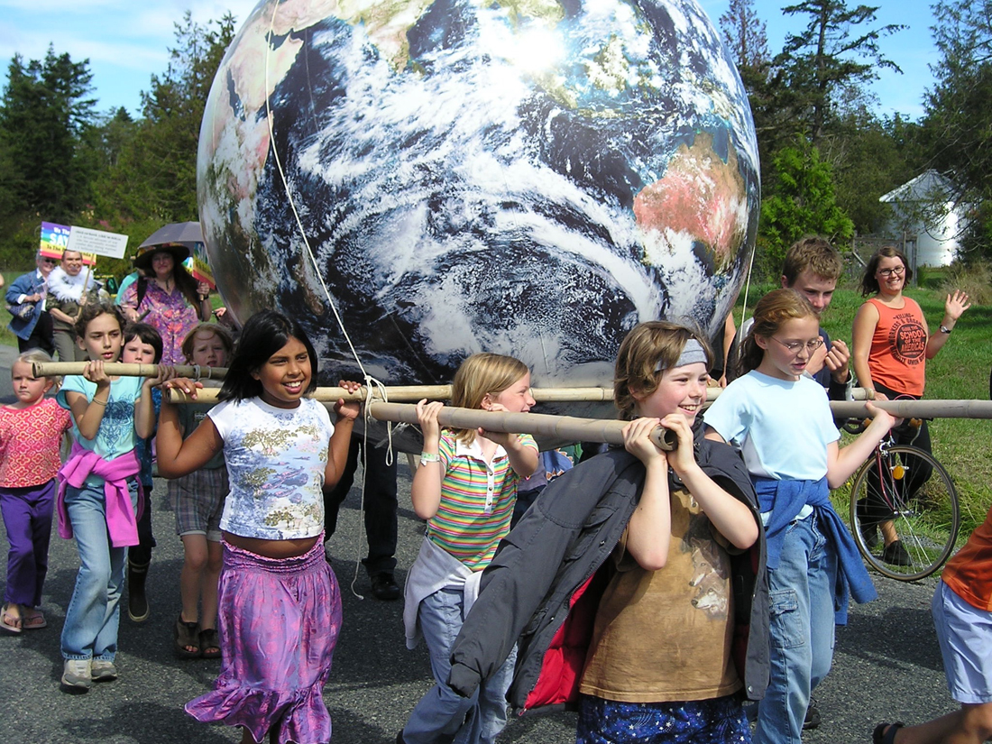 6' World Globe being carried by children in a parade