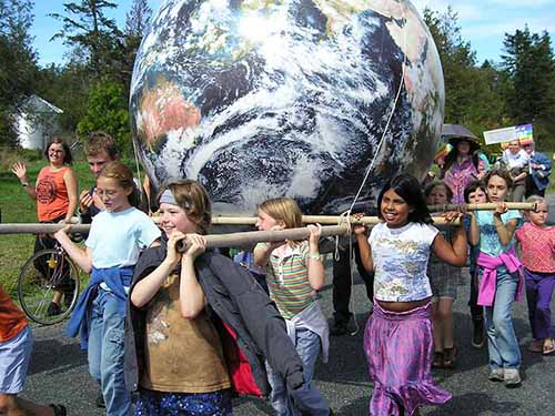 6' diameter giant EarthBall being carried by children in a peace Day Parade